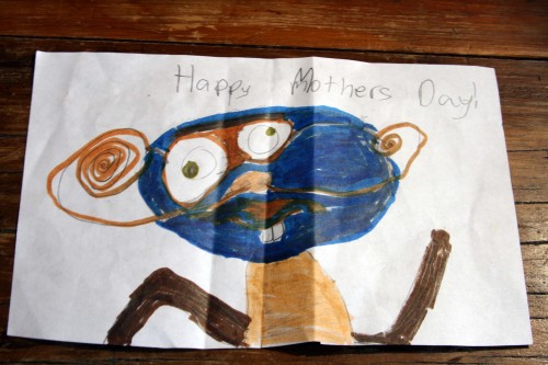 Once you in folded it from its accordian pleats, you find a funny little man wishing me a Happy Mother's Day